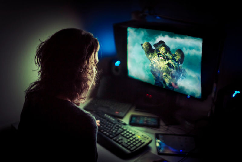 Addicted Computer Gamer Playing Late At Night